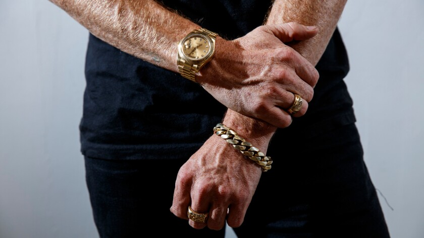 White's all-gold accessories include a Rolex, rings representing his two gold medal wins and a chain link bracelet.