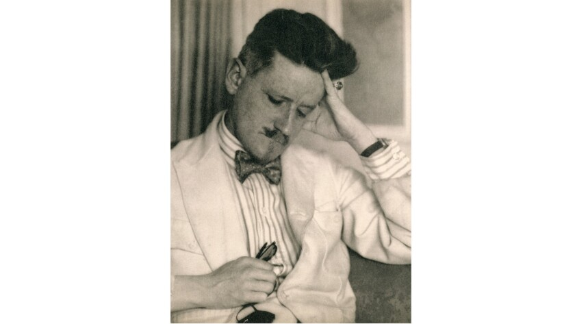 James Joyce in a white suit and bow tie.