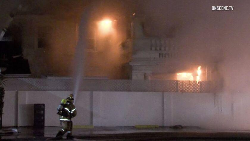 A firefighter battles a blaze at the Anaheim White House Restaurant in the 800 block of South Anaheim Boulevard.