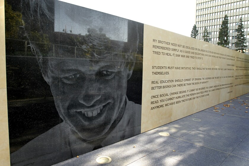 Image of Robert F. Kennedy on a wall outside next to a quote on the wall.