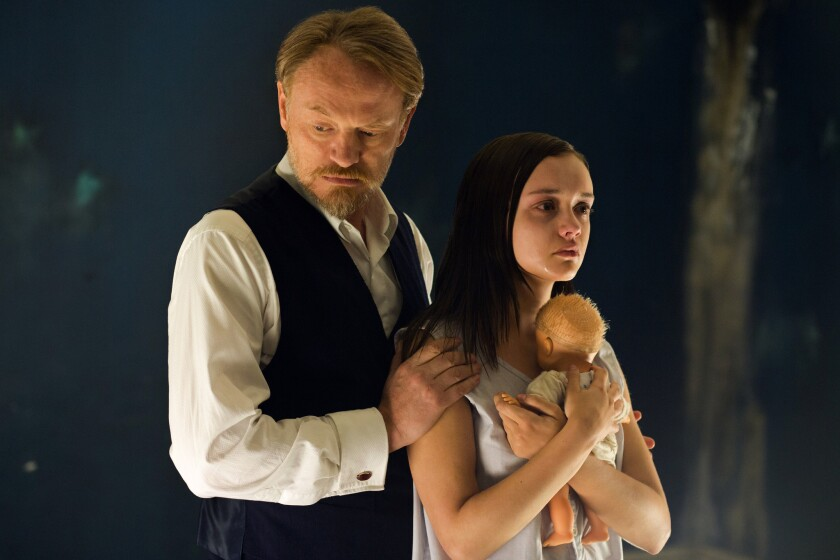 """Olivia Cooke as Jane Harper, right, and Jared Harris as Professor Coupland in the movie """"The Quiet Ones."""""""