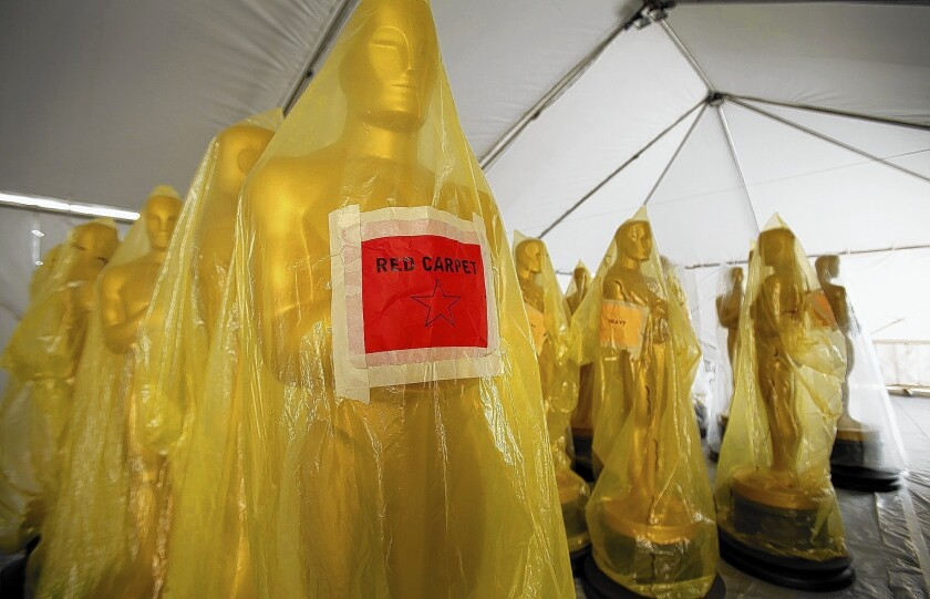 Oscar statues await their gold paint touch-up before they are ready for the red carpet.