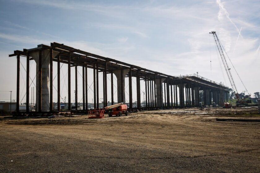 A 3,700-foot viaduct that is being built to extend over State Route 99 in Fresno County for California's high-speed rail line.