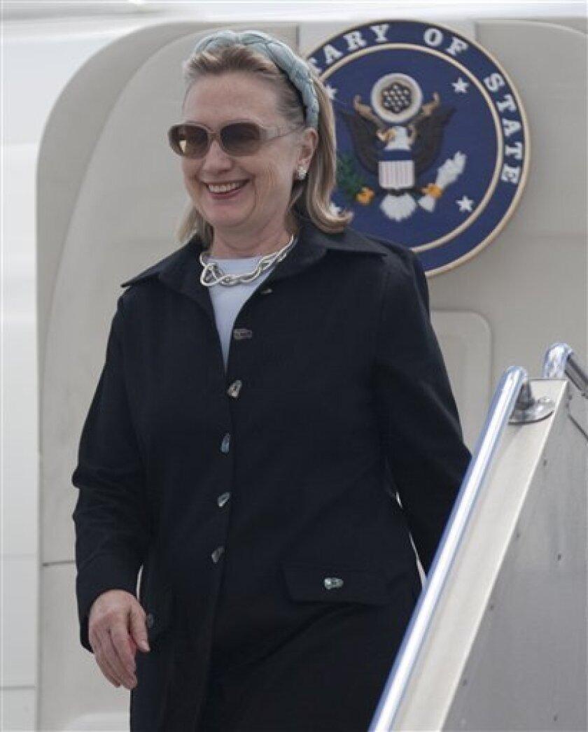 U.S. Secretary of State Hillary Rodham Clinton arrives at Tullamarine Airport Saturday, Nov. 6, 2010 in Melbourne, Australia. (AP Photo/Evan Vucci, Pool)