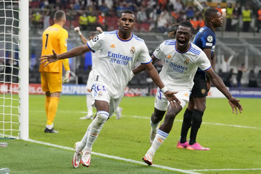 Real Madrid's Rodrygo, left, celebrates with Real Madrid's Eduardo Camavinga after scoring his sides first goal during the Champions League group D soccer match between Inter Milan and Real Madrid at the San Siro stadium in Milan, Italy, Wednesday, Sept. 15, 2021. (AP Photo/Antonio Calanni)
