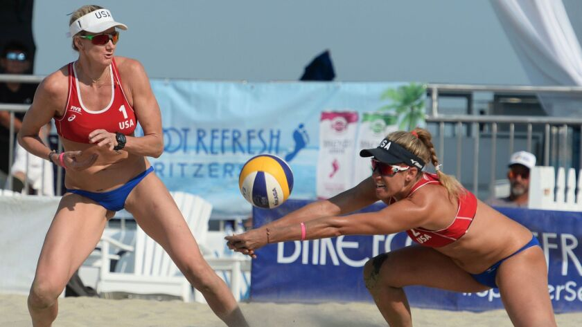 United States' Kerri Walsh Jennings, left, watches April Ross reach for a shot form Brazil's Carol M