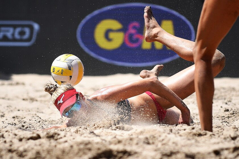 April Ross dives for the ball during the Manhattan Beach Open women's final on Sunday.