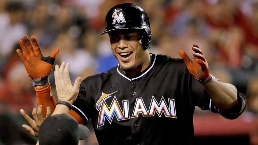 Miami Marlins outfielder Giancarlo Stanton celebrates after hitting a home run against the Angels in August.