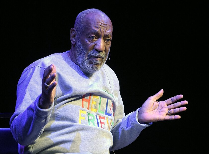 "FILE - In this Friday, Nov. 21, 2014, file photo, Bill Cosby performs during a show at the Maxwell C. King Center for the Performing Arts in Melbourne, Fla. Janice Dickinson sued Cosby for defamation on Wednesday, May 20, 2015, in Los Angeles Superior Court, over denials of rape allegations the comedian's camp issued last year. Dickinson said last year that Cosby raped her in a Lake Tahoe, Calif., hotel room in 1982 and the comedian's lawyer called the allegations ""false and outlandish."" (AP Photo/Phelan M. Ebenhack, File)"