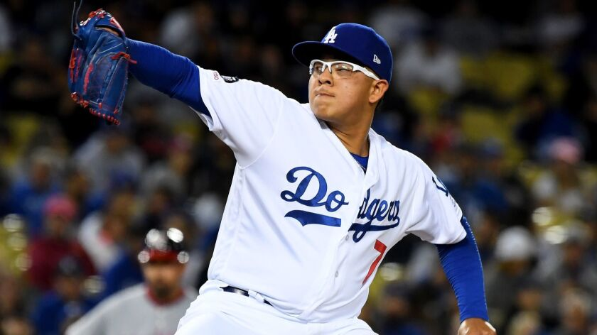 Dodgers relief pitcher Julio Urias delivers in the seventh inning against the Washington Nationals at Dodger Stadium on Friday.