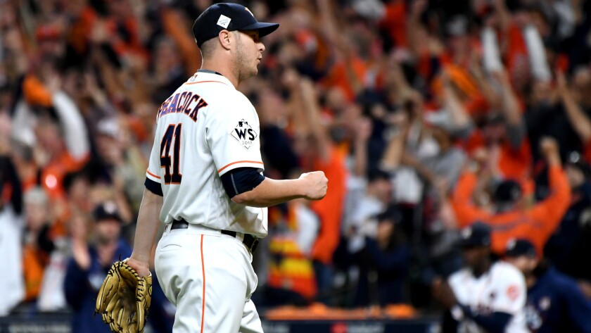 HOUSTON, TEXAS OCTOBER 27, 2017-Astros relief pitcher Brad Peacock pumps his fist after defeating th