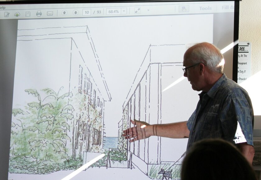 Architect Paul Benton, representing MCASD in its planned expansion, reviews exterior elements on the south side of a proposed new building (right). A stairway leading up from a new parking garage is also planned here, adjacent the In Eden apartment complex (left), which will also undergo some form of renovation in the coming years.