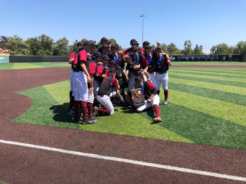 JSerra's baseball team gathers for a photo after winning the championship game.