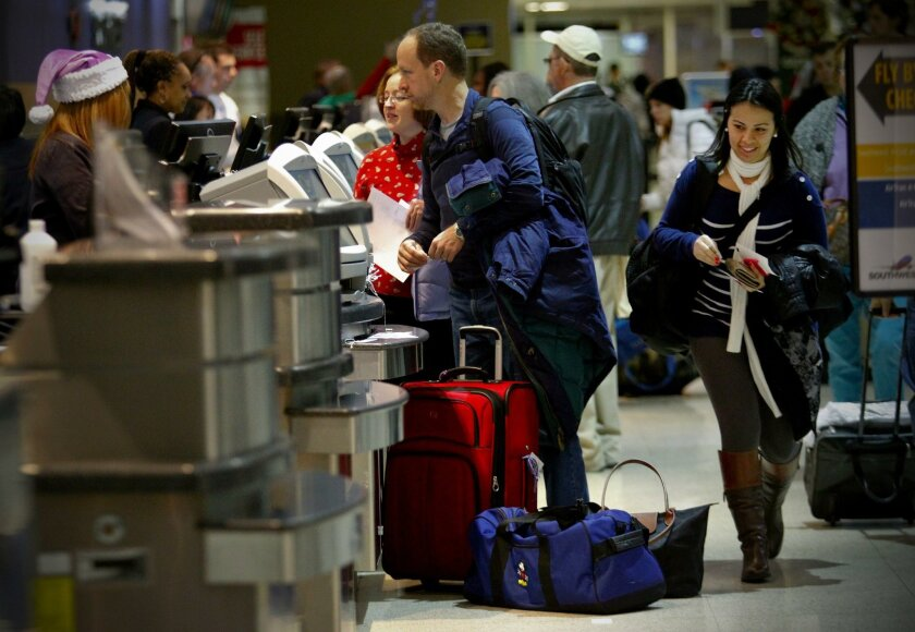 Last year's more than 20 million passengers coming through San Diego International Airport marked a new record, driven by an improving economy and rebounding tourism industry.