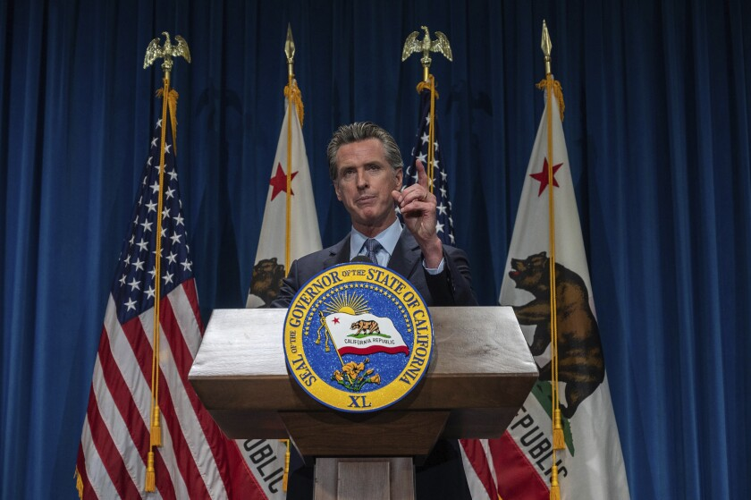 California Gov. Gavin Newsom answers questions from reporters