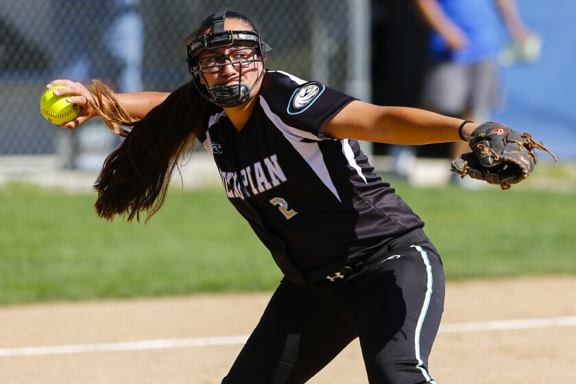 Olympian pitcher Reina Serrano throws to first after fielding a bunt in the third inning against Eastlake.