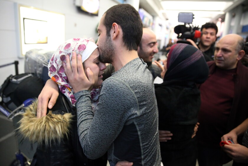 Baraa Haj Khalaf, left, gets a kiss from her brother, Uday Haj Khalaf, after arriving at O'Hare International Airport in Chicago on Feb. 7, 2017, as a federal appeals court heard arguments on whether to restore President Donald Trump's immigration order.