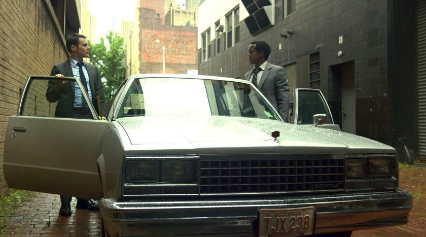 "Jonathan Groff and Albert Jones get into a car in ""Mindhunter"" Season 2."
