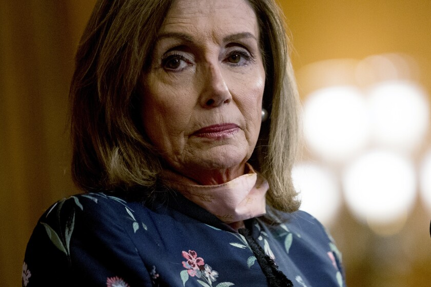 """House Speaker Nancy Pelosi of Calif., pauses during a news conference on Capitol Hill in Washington, Wednesday, July 15, 2020, to mark two months since House passage of """"The Heroes Act"""" or the Health and Economic Recovery Omnibus Emergency Solutions Act. (AP Photo/Andrew Harnik)"""