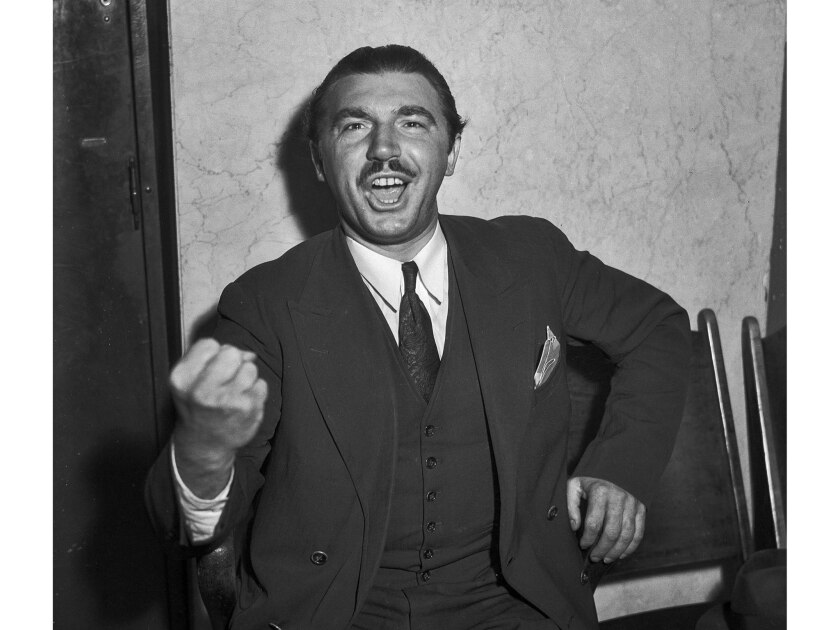 April 10, 1936: Andrew Schwarzman, writer, is shown demonstrating the singing he did under the windo