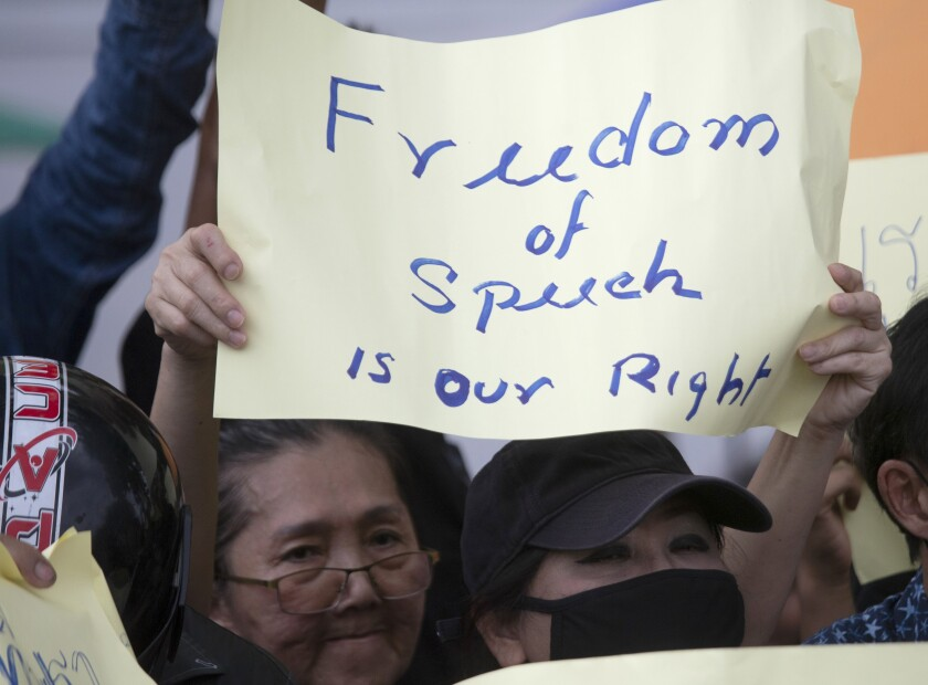 A pro-democracy protester holds up a poster during a rally in Bangkok, Thailand, Sunday, Aug, 16, 2020. Protesters have stepped up pressure on the government if it failed to meet their demands, which include holding of new elections, amending the constitution, and an end to intimidation of critics. (AP Photo/Sakchai Lalit)