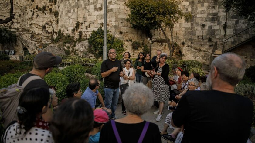 JERUSALEM, ISRAEL -- THURSDAY, MAY 24, 2018: Anwar Ben Badis leads a Ramadan tour at the Old City in