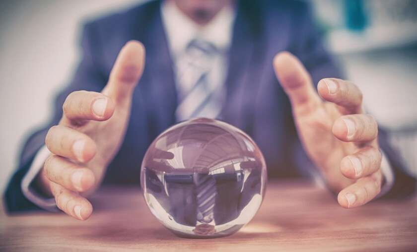 man looking into crystal ball to predict future