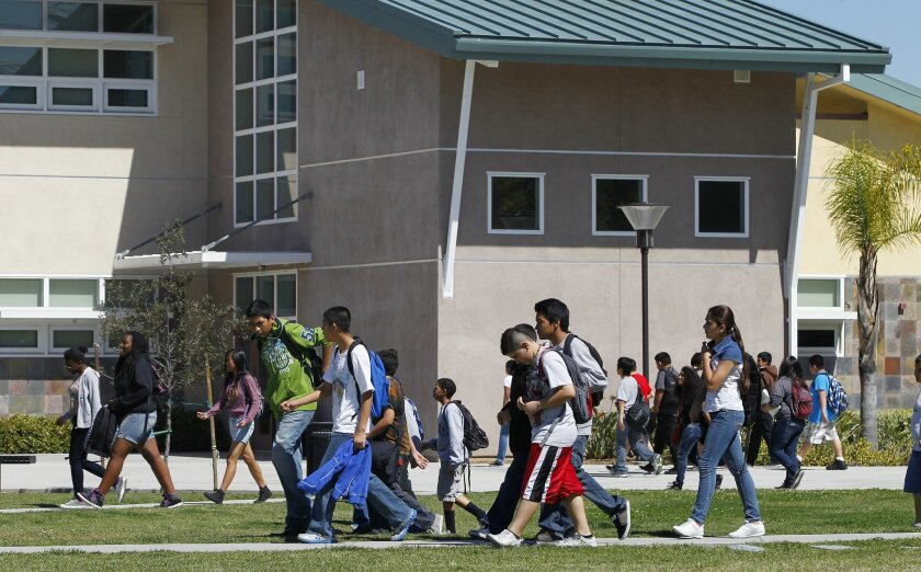 Students cross the quad at Cajon Valley Middle School where, unlike last year, no teachers received pink slips warning of possible layoffs. The budget calls for restoring staff and reducing class sizes next year.
