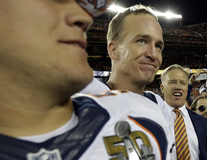 John Elway, General Manager and Executive Vice President of Football Operations for the Denver Broncos, right, celebrates with Denver Broncos' Peyton Manning after the NFL Super Bowl 50 football game against the Carolina Panthers Sunday, Feb. 7, 2016, in Santa Clara, Calif. The Broncos won 24-10.(A