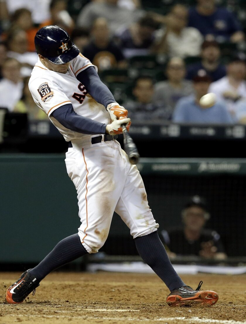 Houston Astros' George Springer connects for a solo home run, his second of the baseball game, against the Colorado Rockies in the seventh inning Monday, June 15, 2015, in Houston. (AP Photo/Pat Sullivan)