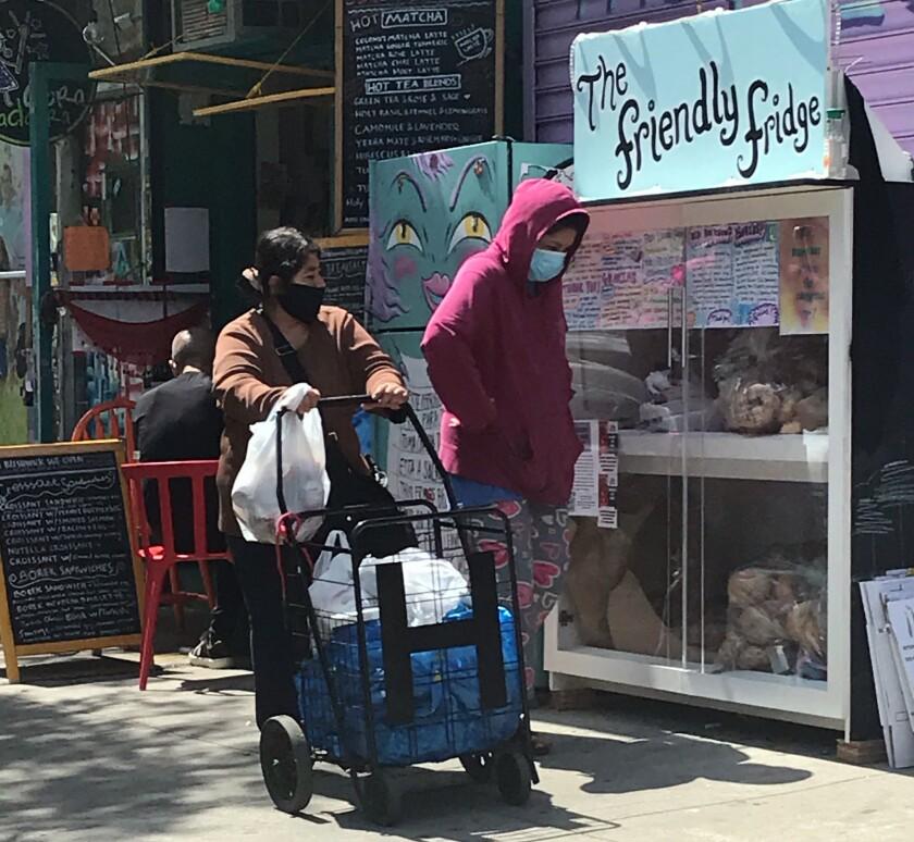 Residents can leave food donations in a community fridge, located on Knickerbocker Avenue in Bushwick, Brooklyn.