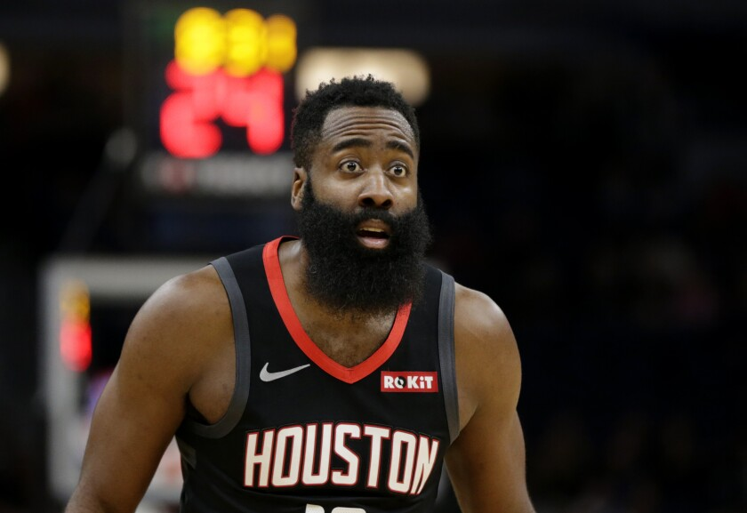 Houston Rockets guard James Harden looks at an official in the first quarter of a basketball game against the Minnesota Timberwolves Saturday, Nov. 16, 2019 in Minneapolis. (AP Photo/Andy Clayton- King)