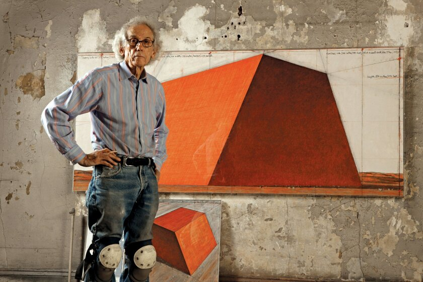 New York City, 2012: Christo in his studio with a preparatory drawing for The Mastaba, Project for Abu Dhabi, United Arab Emirates. Photo: Wolfgang Volz.