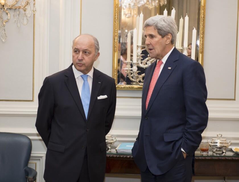 Laurent Fabius, John Kerry