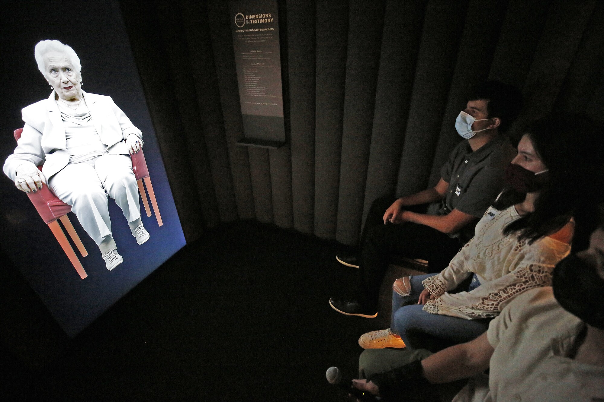 Students virtually interact with a holographic image of 97-year-old Holocaust survivor Renee Firestone.