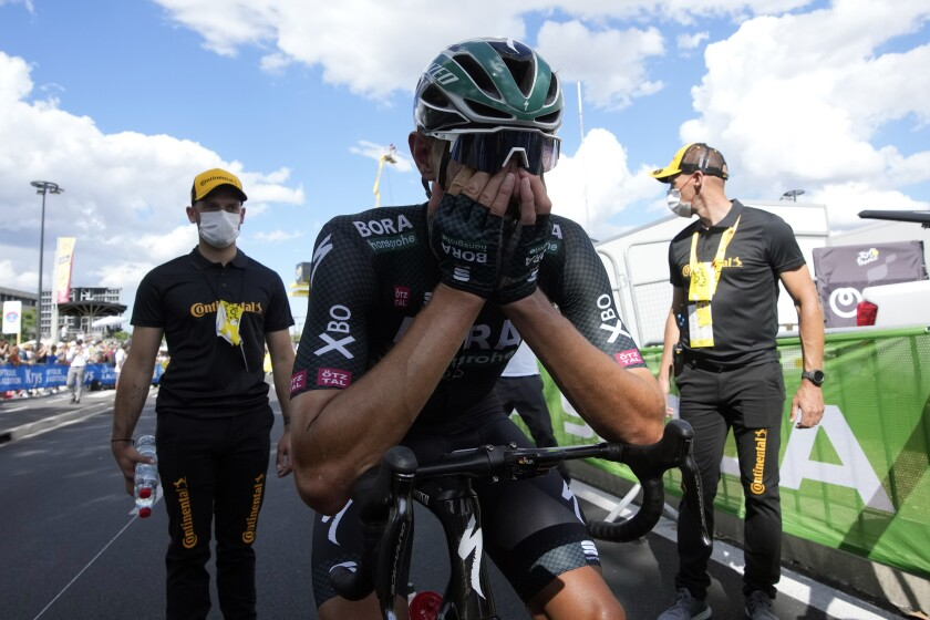 German Nils Politt celebrates after winning the twelfth stage of the Tour de France cycling race over 159.4 kilometers (99 miles) with start in Saint-Paul-Trois-Chateaux and finish in Nimes, France, Thursday, July 8, 2021. (AP Photo/Christophe Ena, Pool)