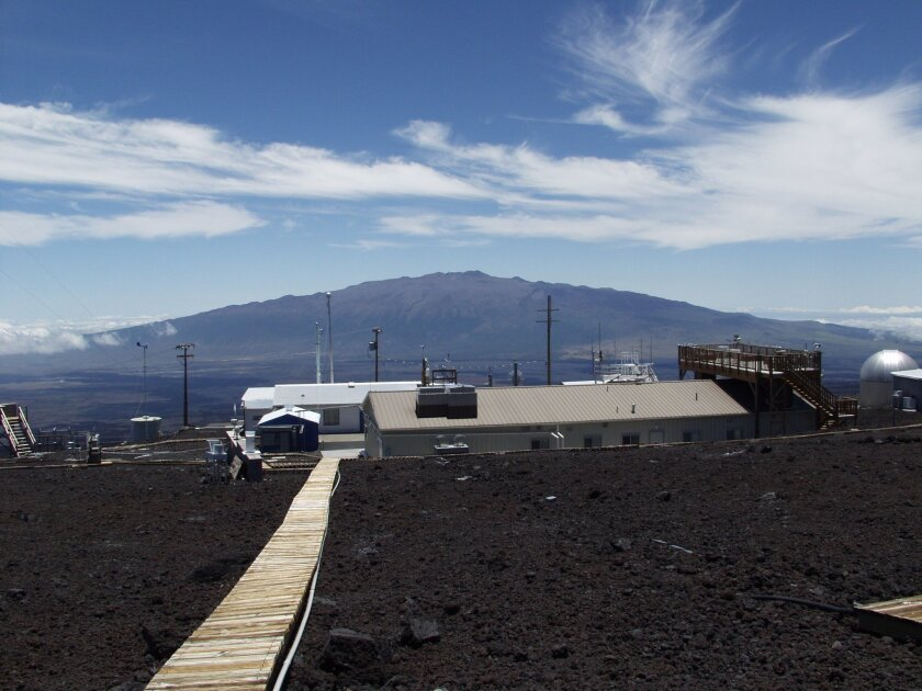 Mauna Loa Observatory in Hawaii. Measurements show the amount of heat-trapping carbon dioxide in the air jumped by the biggest amount on record in April, a rise amplified by El Nino, scientists say. (NOAA via AP)