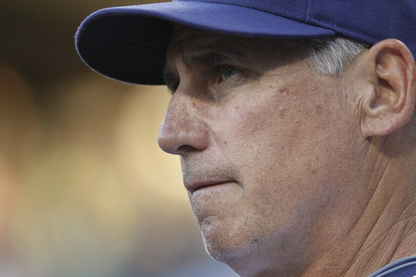 Padres manager Bud Black watches his team play the Mets from the dugout in the first inning.