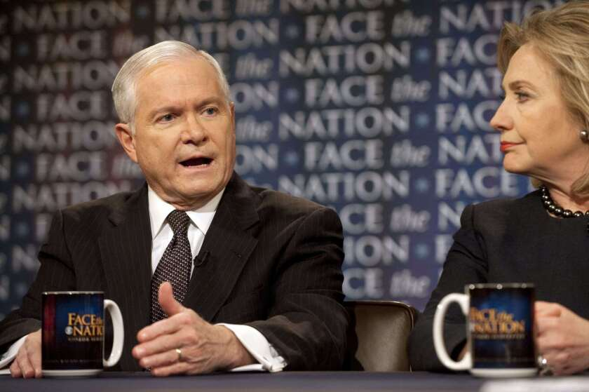 Robert Gates with Hillary Rodham Clinton