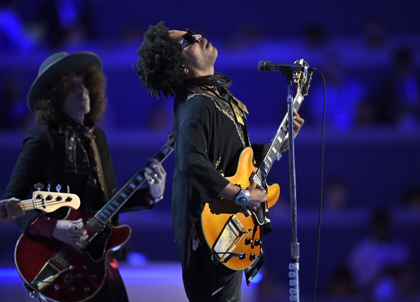 """FILE - Singer Lenny Kravitz performs during the Democratic National Convention in Philadelphia on July 27, 2016. In a new memoir, """"Let Love Rule,"""" Kravitz explores his childhood and ends with him on the verge of stardom and deeply in love with actress Lisa Bonet. (AP Photo/Mark J. Terrill, File)"""