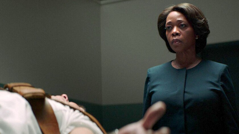 "Alfre Woodard and Alex Castillo in the movie ""Clemency."""