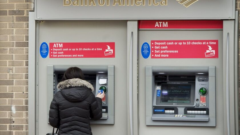 A woman using an ATM at a Bank of America branch in Washington in February 2017.