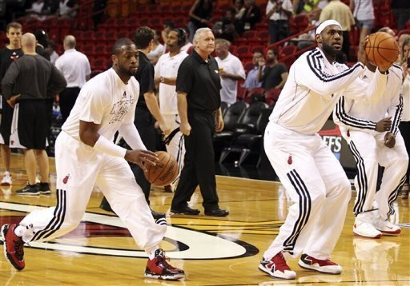 Miami Heat's Dwyane Wade and LeBron James warm up before facing the Chicago Bulls in Game 2 of their NBA basketball playoff series in the Eastern Conference semifinals on Wednesday, May 8, 2013, in Miami. (AP Photo/The Miami Herald, Charles Trainor Jr)