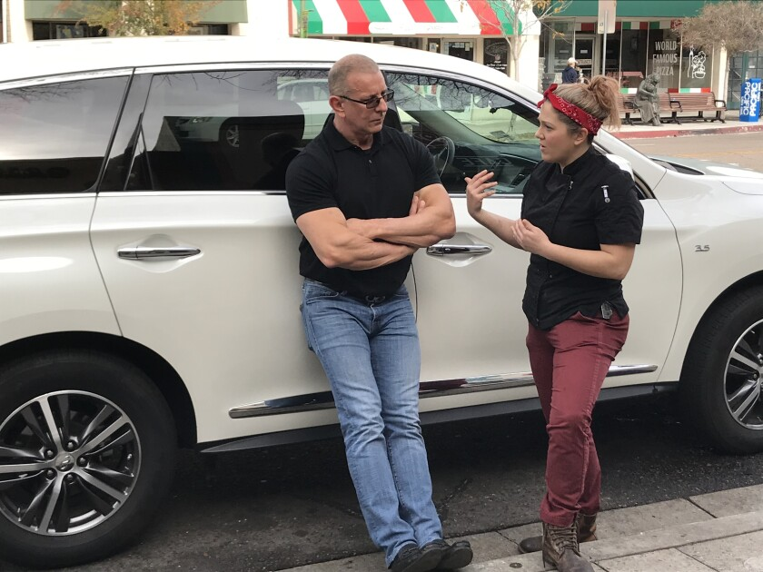 "Chef Robert Irvine discusses changes at Rosie's Cafe in Escondido with owner Kaitlyn Rose during filming of the Food Network series ""Restaurant: Impossible"" in January. The episode will air on April 20."