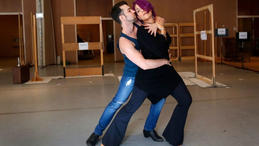 "Stage director John de los Santos rehearses some dance moves with mezzo-soprano Audrey Babcock who plays the title role in San Diego Opera's tango opera ""Maria de Buenos Aires,"" which will be performed at the Lyceum Theatre Jan. 26-28."