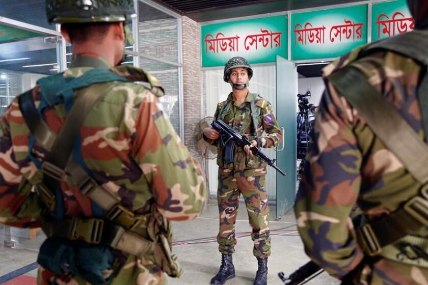 Bangladeshi Army solders stand guard at the Election Commission office in Dhaka, Bangladesh, 31 December 2018. According to local media, Chief Election Commissioner KM Nurul Huda has ruled out any scope of holding fresh election as demanded by opposition alliance Jatiya Oikyafront. EFE/EPA