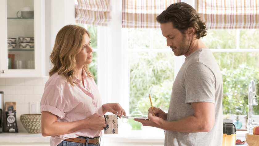 "Jenna Fischer and Oliver Hudson costar in a new episode of the broken-family comedy ""Splitting Up Together"" on ABC."