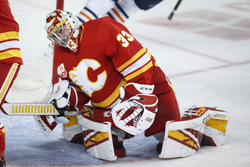 Calgary Flames goalie David Rittich reacts after giving up a goal to the Edmonton Oilers during the second period of an NHL hockey game Saturday, Feb. 1, 2020, in Calgary, Alberta. (Jeff McIntosh/The Canadian Press via AP)