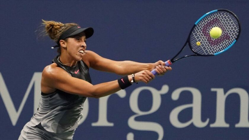 Madison Keys hits a return to CoCo Vandeweghe during the U.S. Open semifinals.