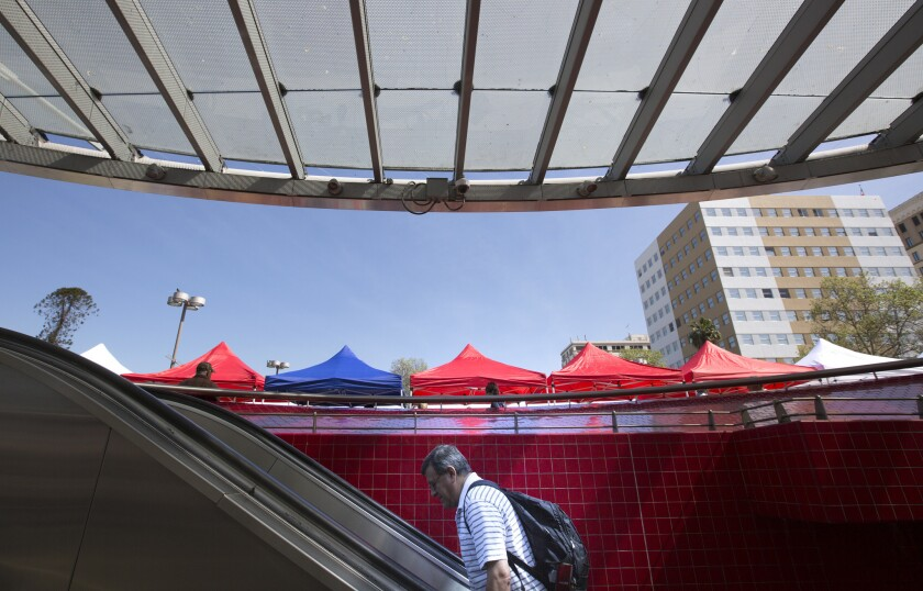 The tops of new pop-up tents for vendors at the Westlake/MacArthur Park Metro Line station.